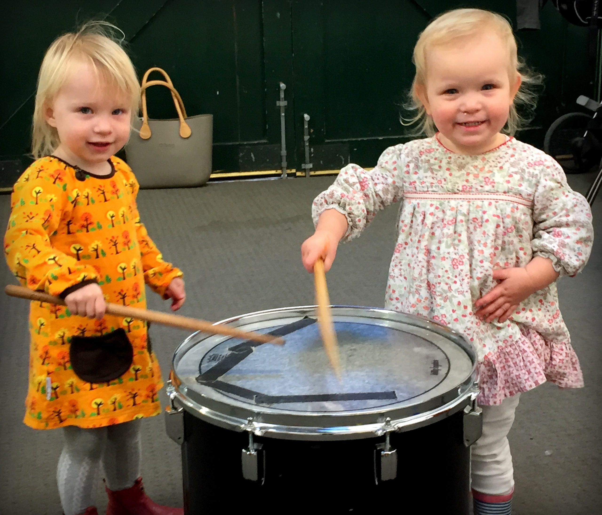 Toddlers playing a drum